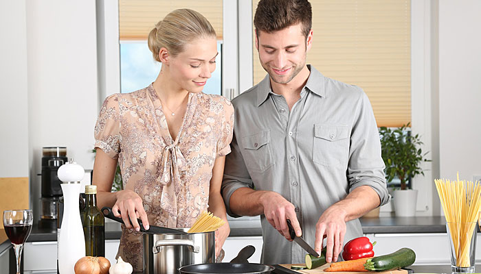 Healthy couple preparing healthy food